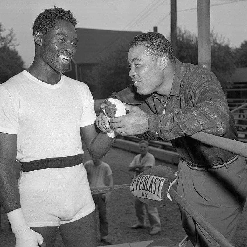 Joe Louis R) giving advice to a young Ezzard charles L).
