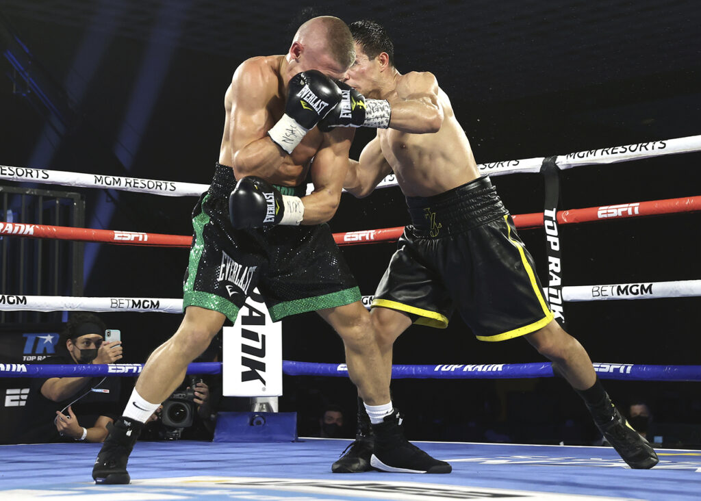 Jose Zepeda (R) slamming Ivan Baranchyk (L). with a jarring left.