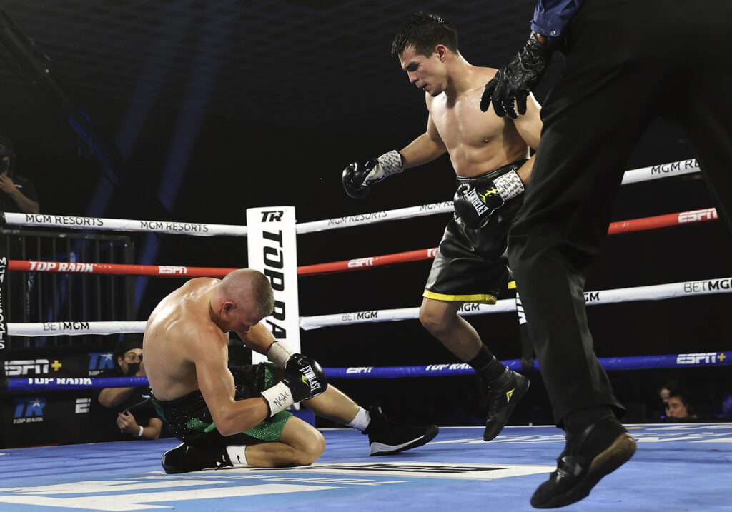 Jose Zepeda (R) knocking down out Ivan Baranchyk (L).