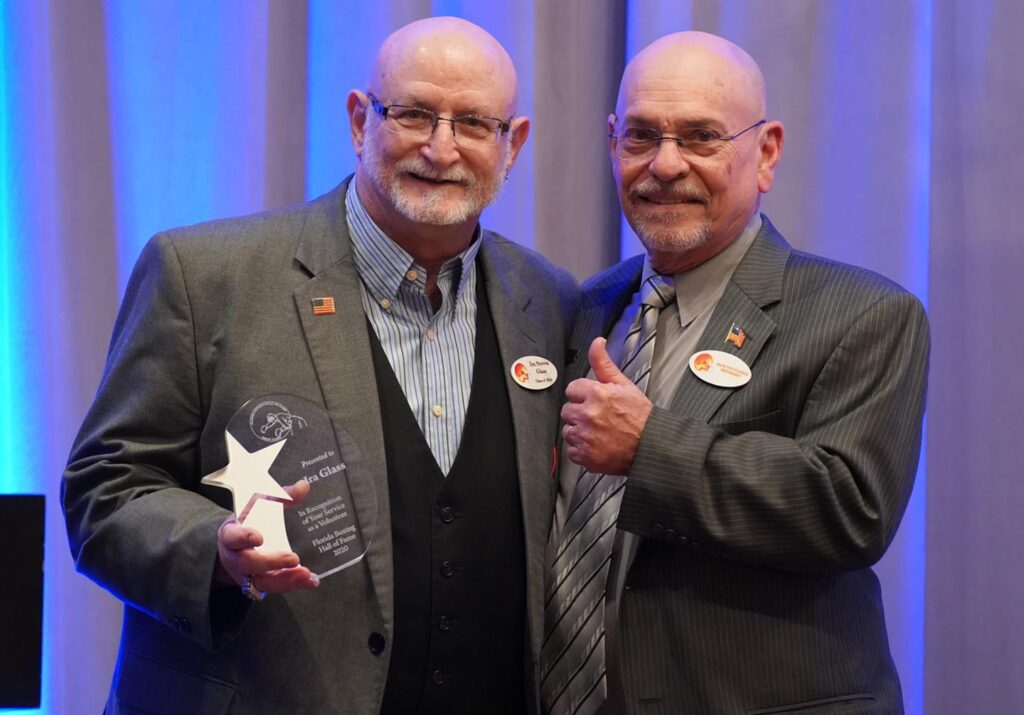 L-R Referee Emilio Lombardo Jr. and FLBHOF President Butch Flansburg.