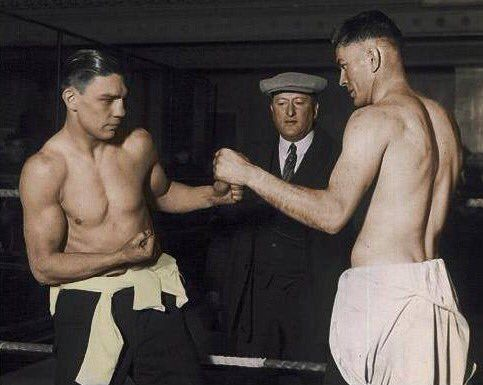 Harry Greb (L) and Gene Tunney (R)  pose for pictures