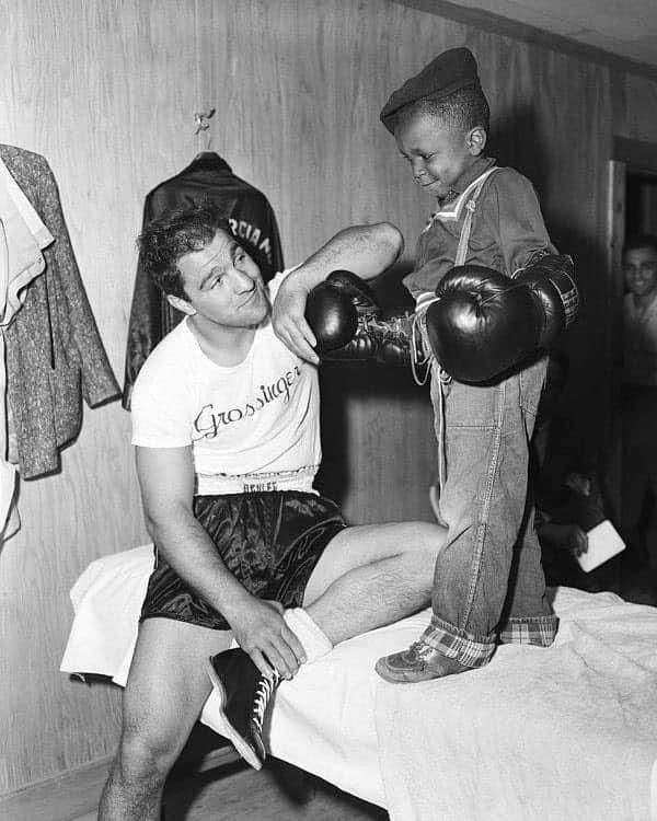 Heavyweight Champion Rocky Marciano kidding around with a young fan.