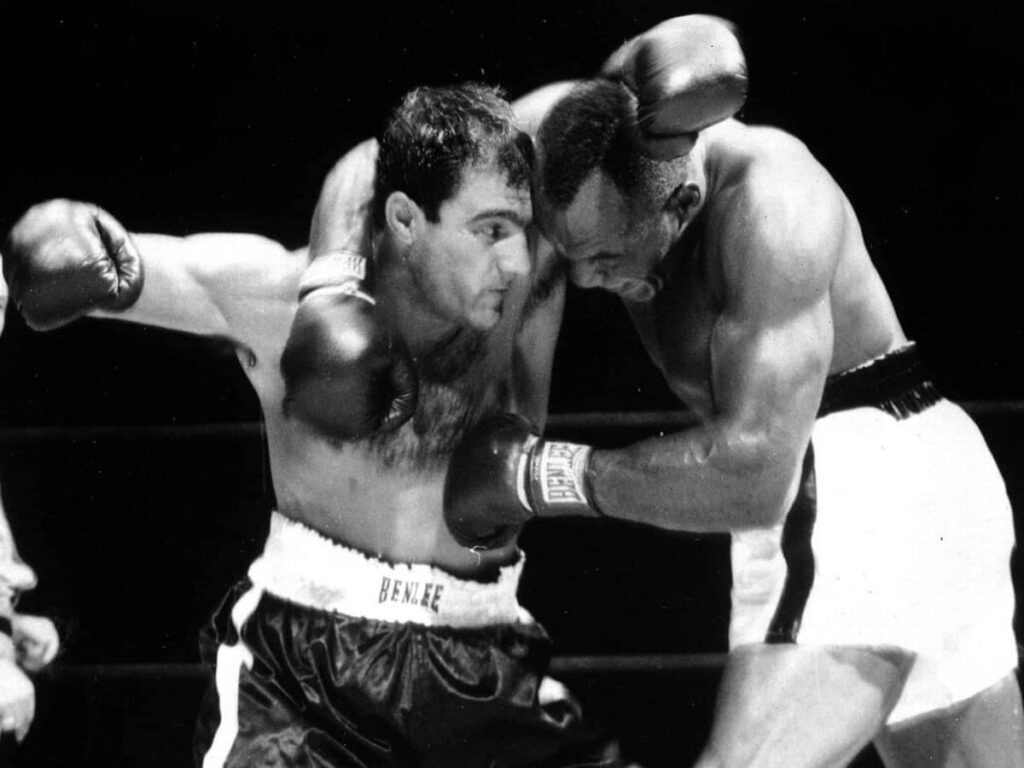 Marciano (L) and Walcott (R) fighting on the inside of the 1952 first fight.