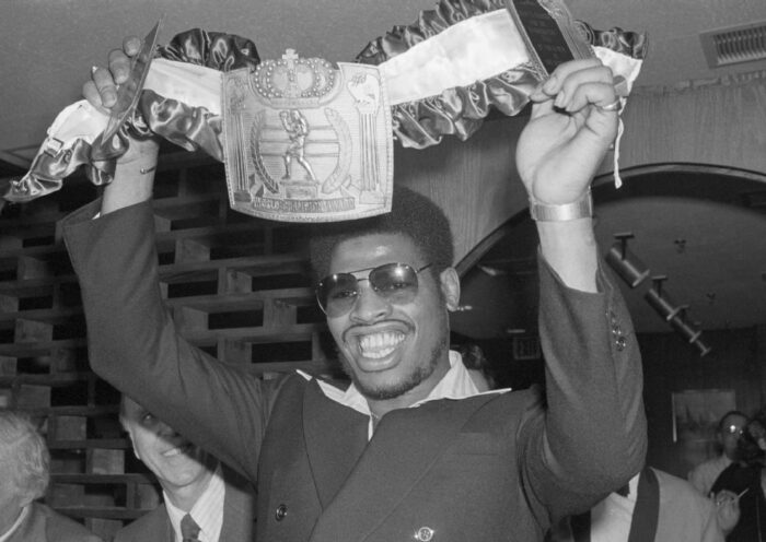 Spinks holding up the Champiinship Belt