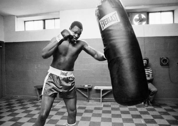 Heavyweight Champion Larry Holmes trains on the heavy bag.