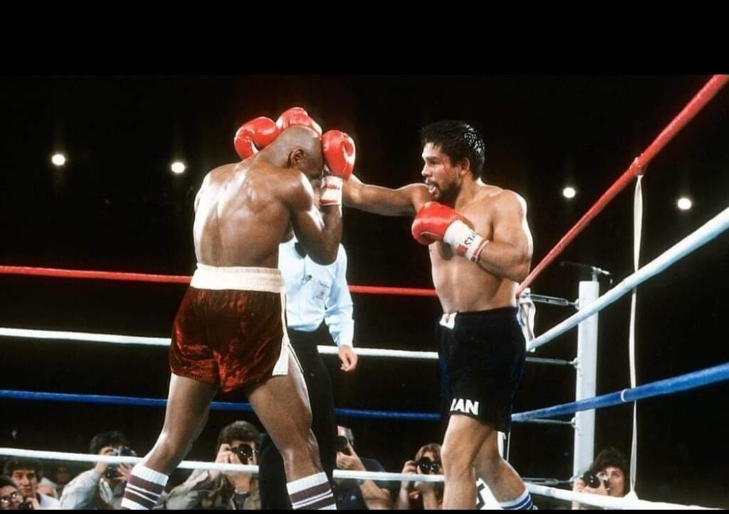 Roberto Duran (R) stabbing Marvelous Marvin Hagler (L) with a hard right.