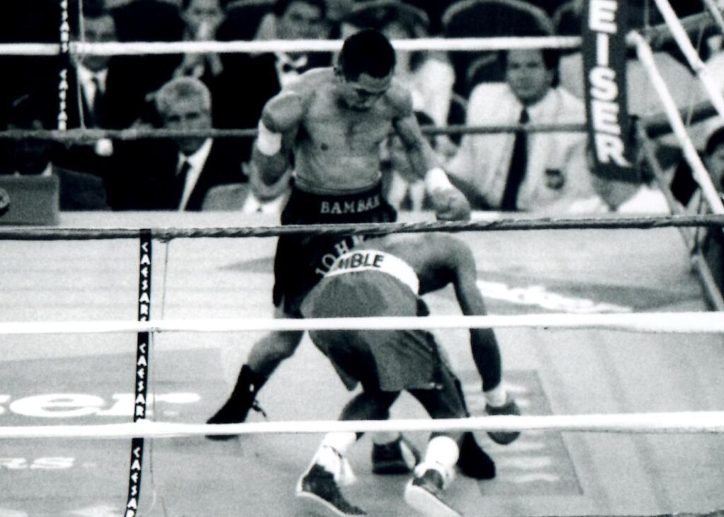 """John Michael """"Bam Bam,"""" Johnson (L) won the WBA bantamweight title by knocking out Junior Jones (R) in the 11th round on April 22, 1994 at Caesars Palace in Las Vegas, Nevada. (PHOTO BY ALEX RINALDI)."""