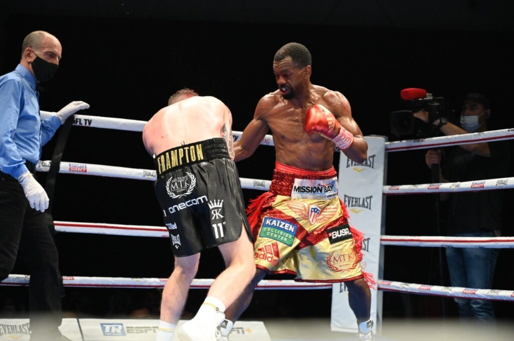 Jamel Herring (R) connects with a thudding right to the body of challenger Carl Frampton (L).